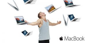 image of a man being showered in apple Macbooks